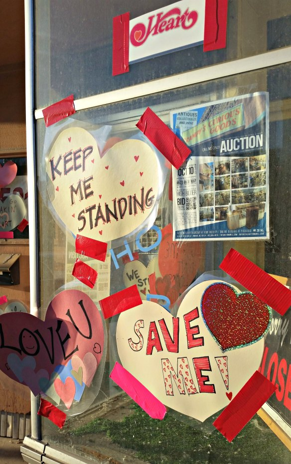 Valentines cover the storefront of the former Grampy's Curious Goods in Benson, Neb.